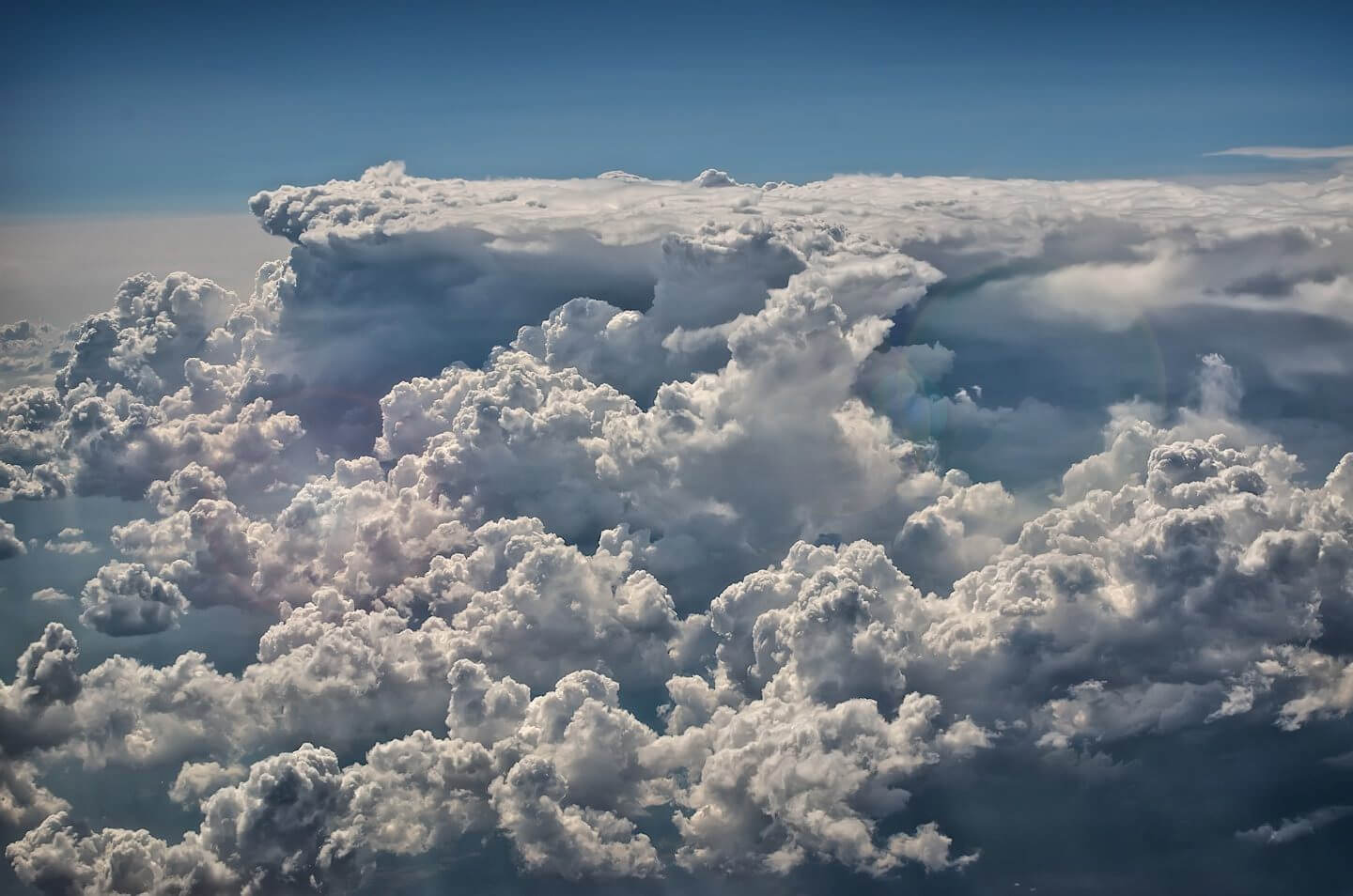 Fluffy clouds over Morocco; sky photographed from a plane
