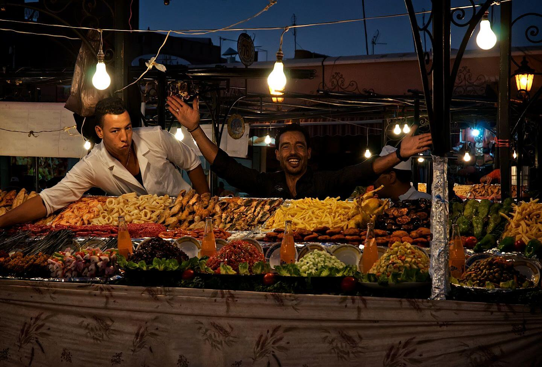 Moroccan restaurant owner greeting customers; Jemaa el-Fnaa square