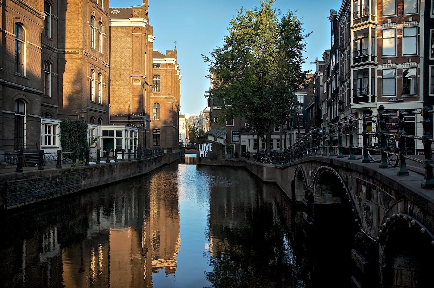 Sun rises over a canal in Amsterdam