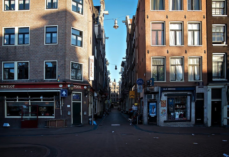 Sunrise on Oudezijds Voorburgwal street in Red Light District